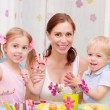 Happy family painted Easter eggs - Stock Photo