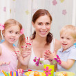 Happy family painted Easter eggs — Stock Photo