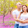 Loving couple on floral field — Stock Photo
