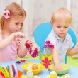 Stock Photo: Children paint Easter eggs