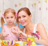 Mother with daughter painted Easter eggs — Stock Photo