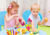 Children paint Easter eggs — Stock Photo