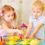 Kids paint Easter eggs — Stock Photo