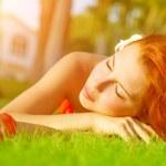 Cute female on green grass — Stock Photo