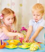 Kids paint Easter eggs — Stock Photo