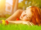 Cute female on green grass — Stock Photo