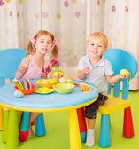 Two children paint Easter eggs — Stock Photo
