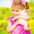 Baby girl with soft toy - Stock Photo