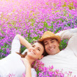 Happy couple on lavender field — Stock Photo #24884267