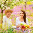 Happy couple on picnic in garden — Stock Photo