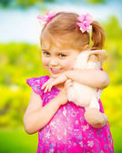 Baby girl with soft toy — Stock Photo