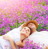 Happy lovers on lavender glade — Stok fotoğraf