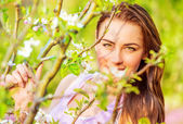 Beautiful female in spring park — Stock Photo