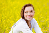 Woman on yellow floral field — Stock Photo