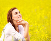 Cute female on yellow floral field — Stock Photo
