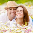Lovely couple outdoors - Stock Photo