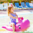 Little girl have fun in aquapark - Photo