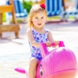 Baby girl in the pool - Stock Photo