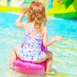 Little girl in poolside — Foto de Stock