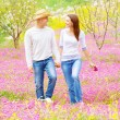 Happy lovers walking outdoors — Stock Photo