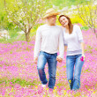 Loving couple walking in spring park — Stock Photo