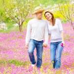Loving couple walking in spring park — Stock Photo