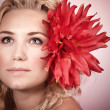 Blond girl with red flower — Stock Photo #25188929
