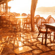 Seaside cafe in sunset light - Stock Photo