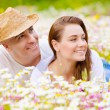 Beautiful couple on chamomile meadow — Stock Photo #25463663