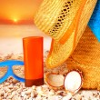 Beach items on sunset - Stock Photo