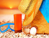 Beach items on sunset — Stock Photo