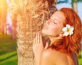Pretty woman on tropical resort — Stock Photo