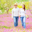 Two lovers in spring garden — Stock Photo