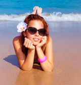 Beautiful female on the beach — Stock Photo
