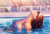 Cute woman in the pool — Stock Photo