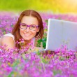 Cute girl with laptop outdoor — Stock Photo