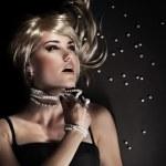 Fashion portrait of a beautiful seductive woman — Stock Photo