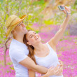 Cute couple photographing of themself — Stock Photo