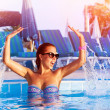 Pretty girl having fun in the pool — Stock Photo #26156437