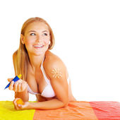 Pretty woman applying suncream — Stock Photo