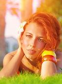 Redhead girl on green grass — Stock Photo
