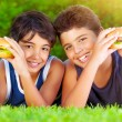 Two boys eating burgers — Stock Photo #26484213