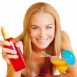 Woman with sunscreen and cocktail — Stock Photo