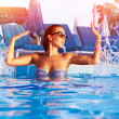 Woman have fun in the pool — Stock Photo
