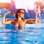 Woman have fun in the pool — Stock Photo
