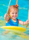 Cute little girl in water park — Stock Photo