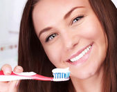 Cute woman clean teeth — Stock Photo