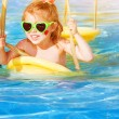 Little girl on water swing — Stock Photo