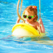 Baby girl swinging on water attractions — Stok fotoğraf