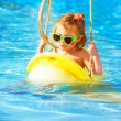 Baby girl swinging on water attractions — Stockfoto